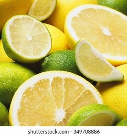 Fresh slices of lime and lemon in close up.