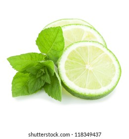 Fresh slices of lime with mint isolated on a white background