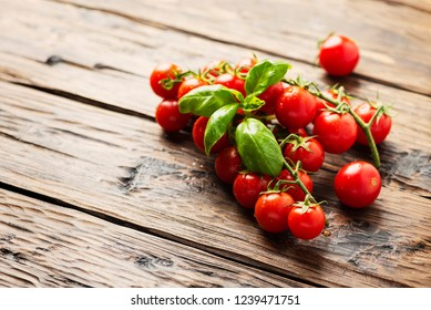 Fresh small tomatoes on the wooden table, selective focus