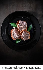Fresh smoked mackeral pate canapes with bay leaves shot from overhead with generous accommodation for copy space. The perfect image for your bistro menu cover art.