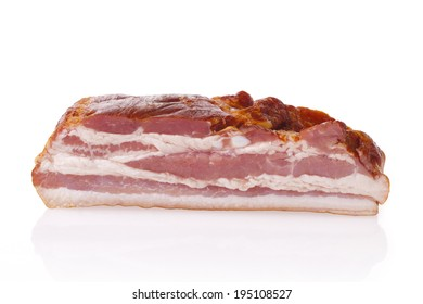 Fresh smoked polish bacon. Meat composition taken on white background with reflection.