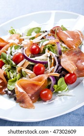 Fresh smoked salmon salad with lettuce tomato and dressing