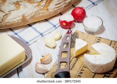 Fresh snack with camembert cheese on an old wooden table