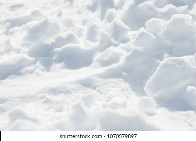 Fresh snow background texture. Winter background with snowflakes and snow mounds. Snow lumps