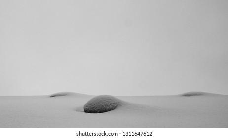 Fresh snow covered rocks