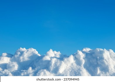 Fresh snow on a background of blue sky