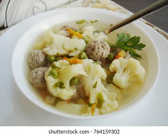 Fresh soup with vegetables and meatballs. Healthy eating concept.
