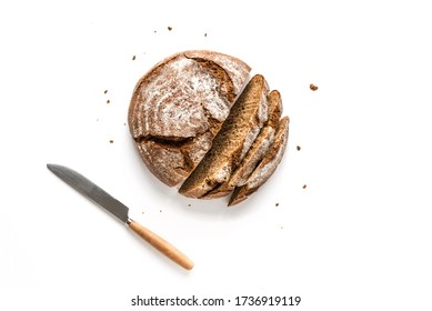 Fresh Sourdough Bread isolated on white background. Fresh baked homemade sliced rye bread, top view, copy space.