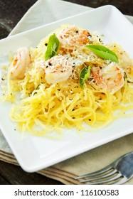 Fresh spaghetti squash with basil and sauteed shrimp in wine sauce