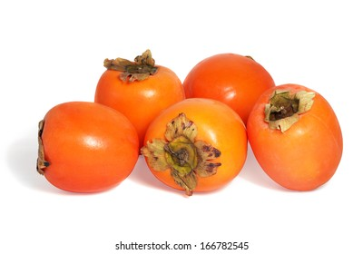 Fresh spanish persimmons on white background.