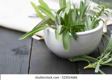 fresh spices on black wooden table background