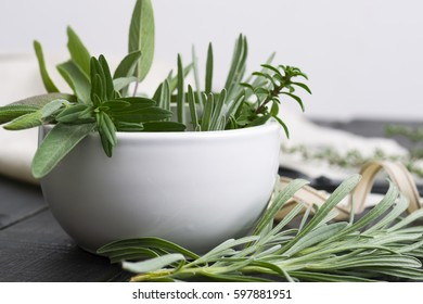 fresh spices and ribbon, on black wooden table background