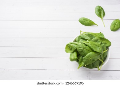Fresh spinach leaves in a plate on a light table