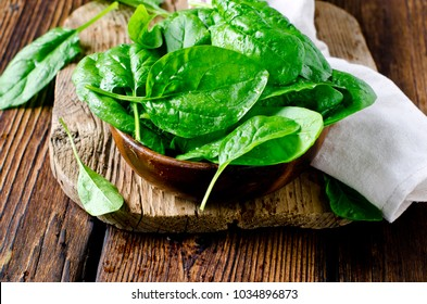 Fresh spinach on a cutting wooden board