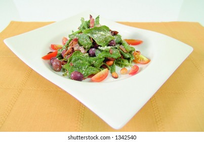 Fresh spinach salad with peanuts and olives