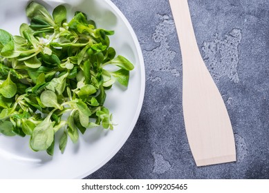 Fresh spinach in white ceramic pan