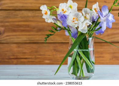 fresh spring daffodil in glass on table