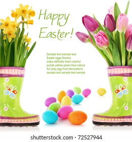 Fresh spring flowers and Easter eggs isolated on white