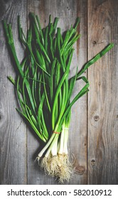 Fresh spring onion on wooden background