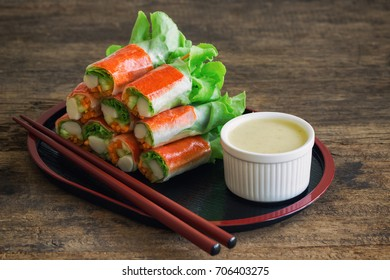Fresh spring rolls with fresh vegetable and crab stick served with wasabi mixed salad cream dipping sauce. Rolls salad or fresh spring roll in Japanese style, healthy tasty food for appetizer or meal.