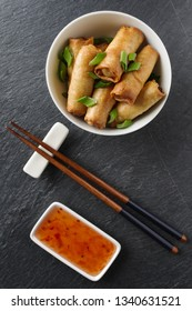 fresh spring rolls with vegetables in small chinese dishware.