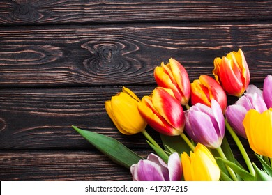 Fresh spring tulips on the boards. The first spring flowers