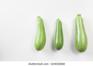 Fresh squashes on white background