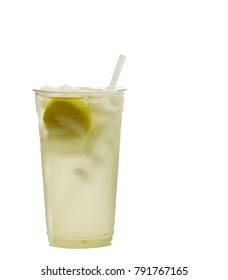 Fresh squeezed lemonade in a clear cup with lemon slices and ice cubes.
