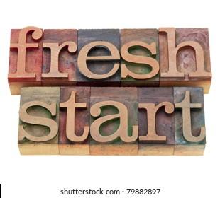fresh start - isolated words in vintage wood letterpress printing blocks
