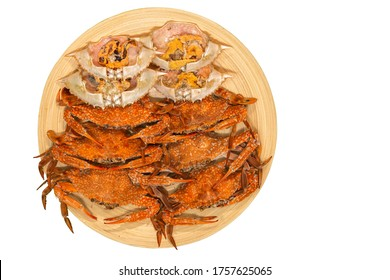 Fresh steamed crab select crab claw on a plate with seafood sauce ready to serve in white background.