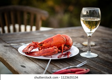 Fresh Steamed Maine Lobster with Wine and Utensils