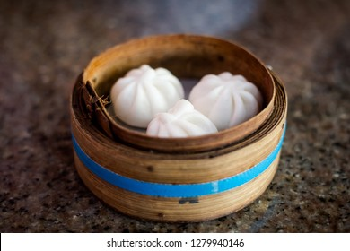 Fresh steamed traditional thai stuffed buns in local restaurant in Trang. Traditional thai dish made of fresh ingredients.