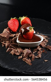 Fresh strawberries array heart shape. Love concept. Valentine's Day Concept. Melting chocolate / melted chocolate.