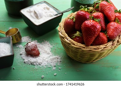 Fresh Strawberries in the basket on the wooden table