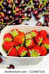 Fresh strawberries and cherries