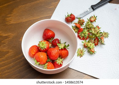 Fresh strawberries are cleaned and cut