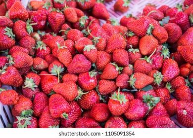 Fresh strawberries fruits on farmer market table