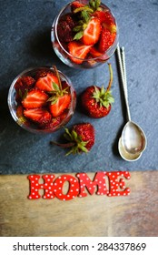 Fresh strawberries in the glasses as a dessert on rustic style table