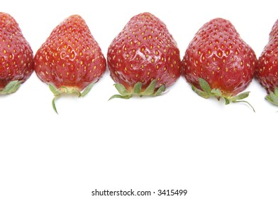 fresh strawberries with hulls in a row, copy space, isolated on white