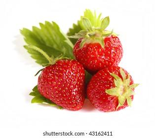 Fresh strawberries isolated on white background - close up