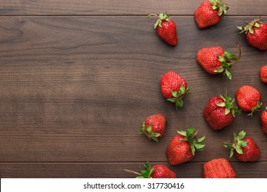 fresh strawberries on the brown wooden table