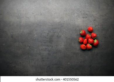 fresh strawberries on grey table desk