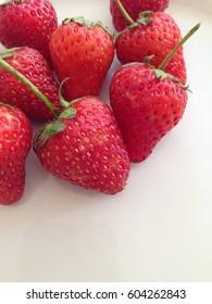 Fresh strawberries on white background