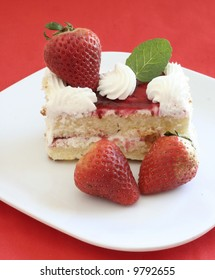Fresh strawberries on white cake