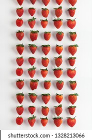 Fresh Strawberries on a white textured background lined up, repeating, and making a pattern. Vibrant and colorful, metaphorically showing how everyone is the same yet different at the same time.