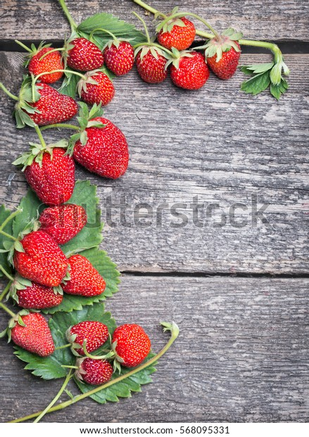Fresh strawberries on a wood background