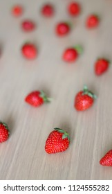 Fresh strawberries on a wooden table. Selective focus.