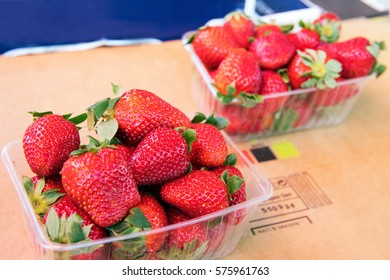 Fresh strawberries in plastic box