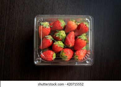 Fresh strawberries in plastic container