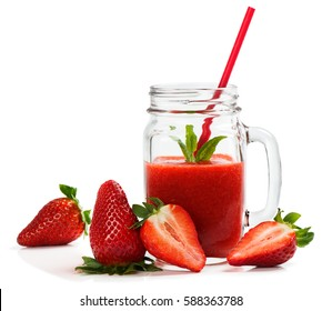 Fresh strawberries and smoothie in a mason jar isolated on white background.